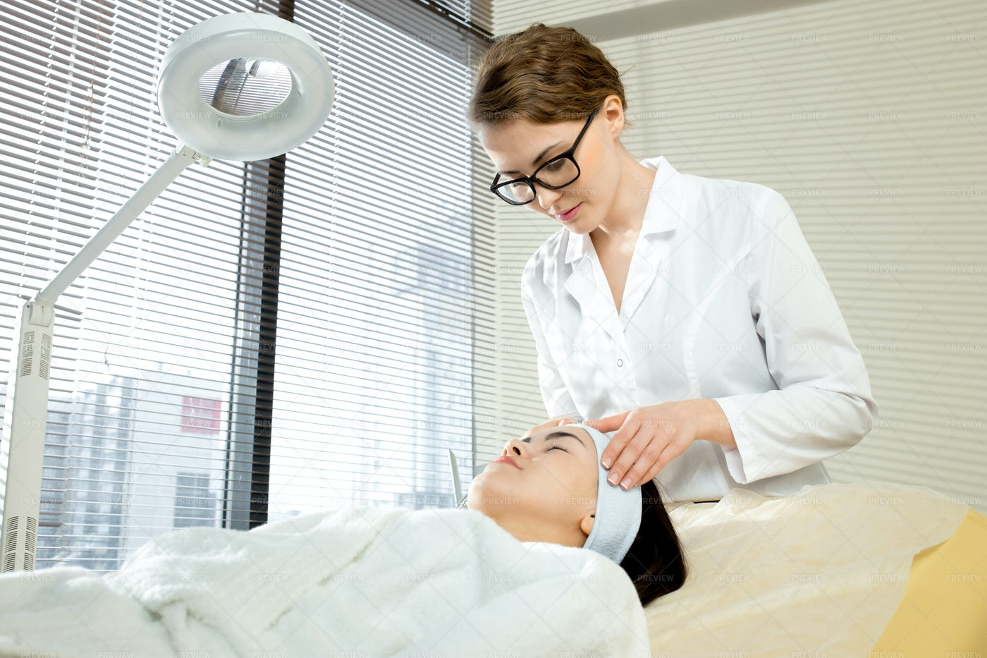 Young Cosmetologist Focused On Work: Stock Photos