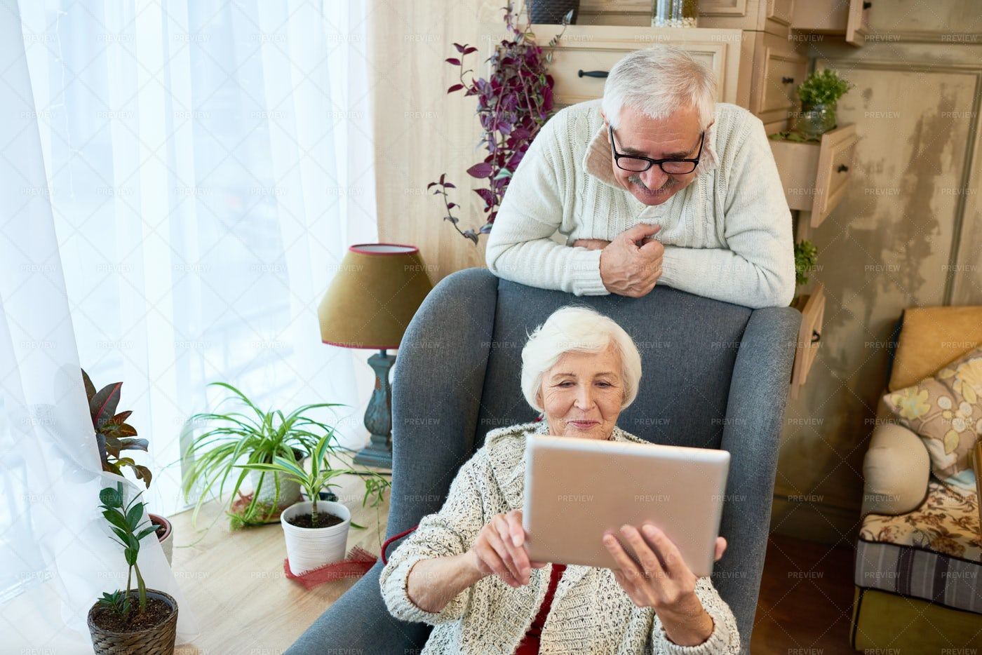 Senior Woman Using Digital Tablet: Stock Photos