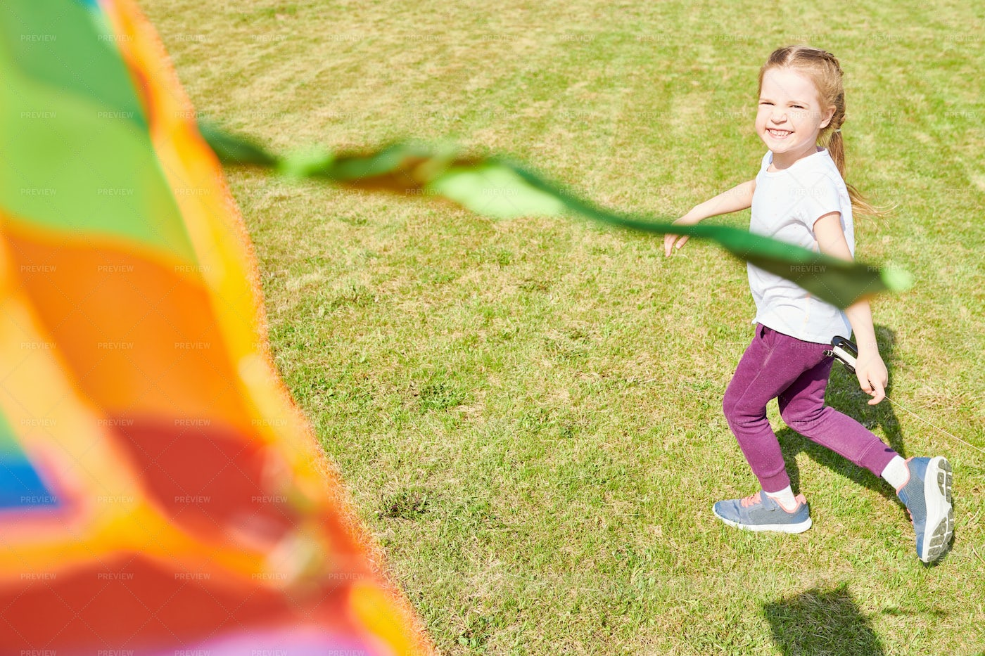 Happy Girl Running With Colorful...: Stock Photos