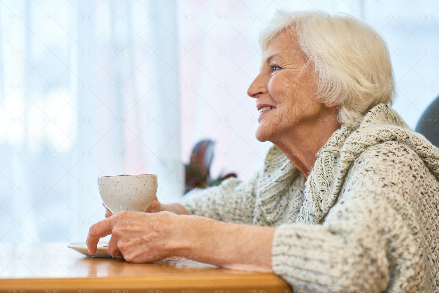 Senior Woman With Cup Of Fragrant...: Stock Photos