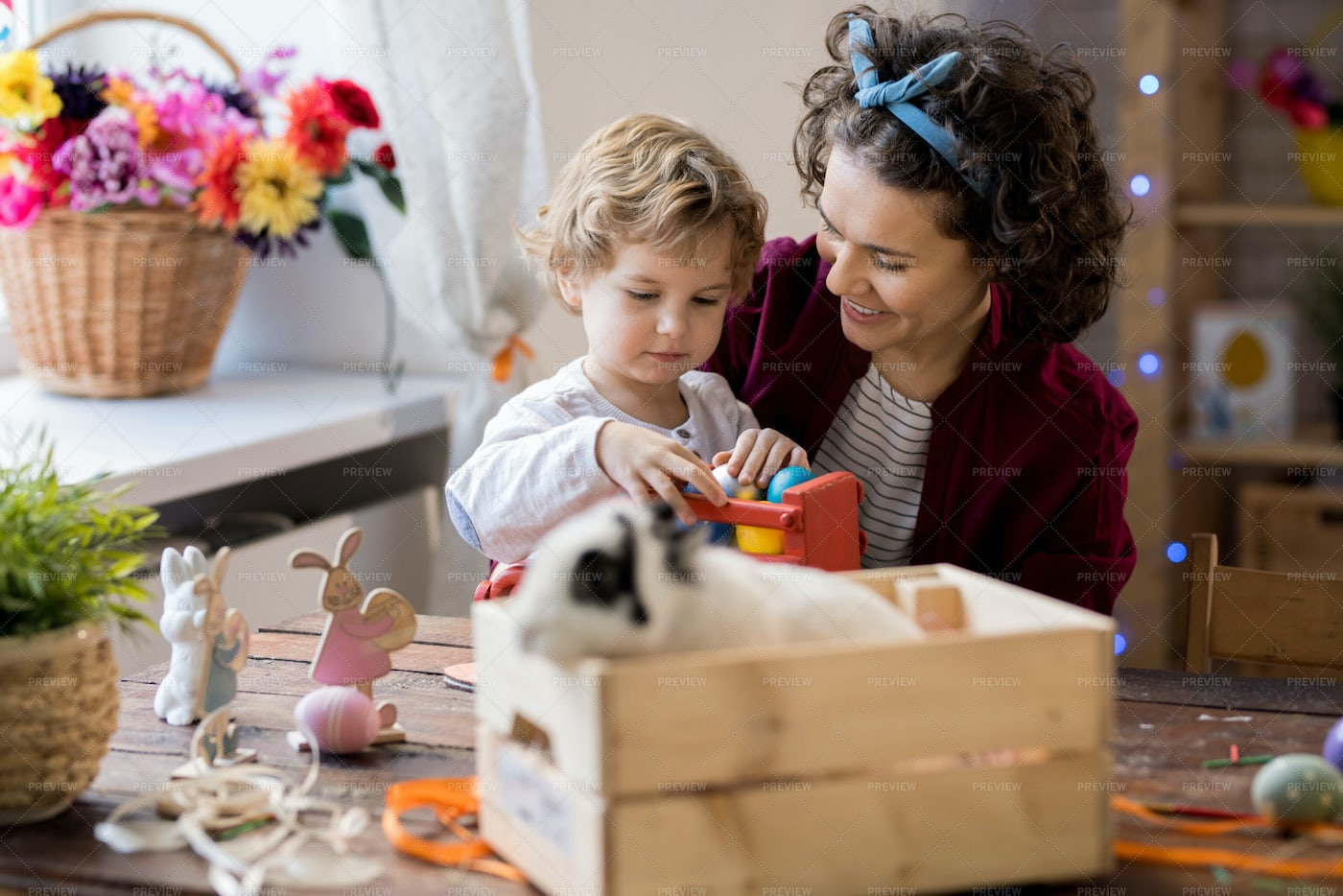 Woman Playing With Son On Easter: Stock Photos