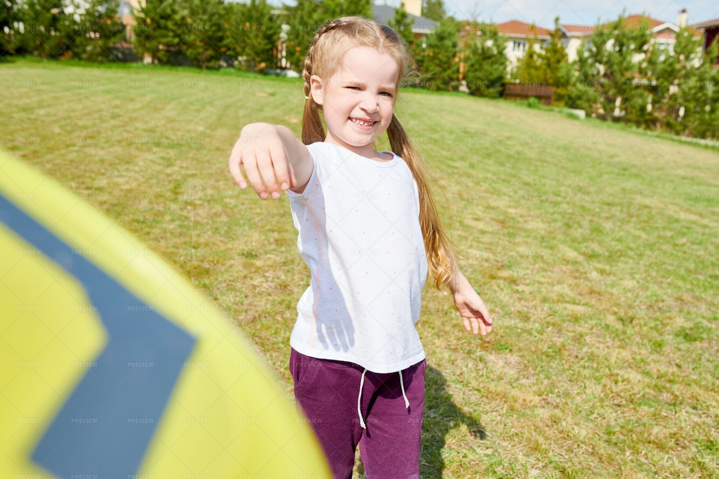 Girl Playing With Flying Disc: Stock Photos