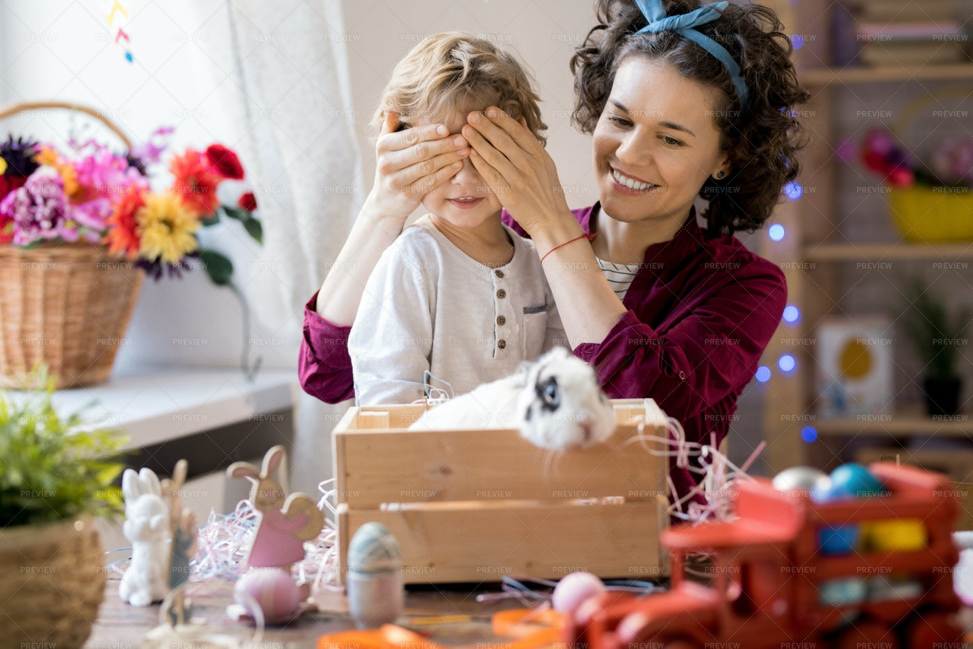Mother Presenting Easter Bunny To...: Stock Photos