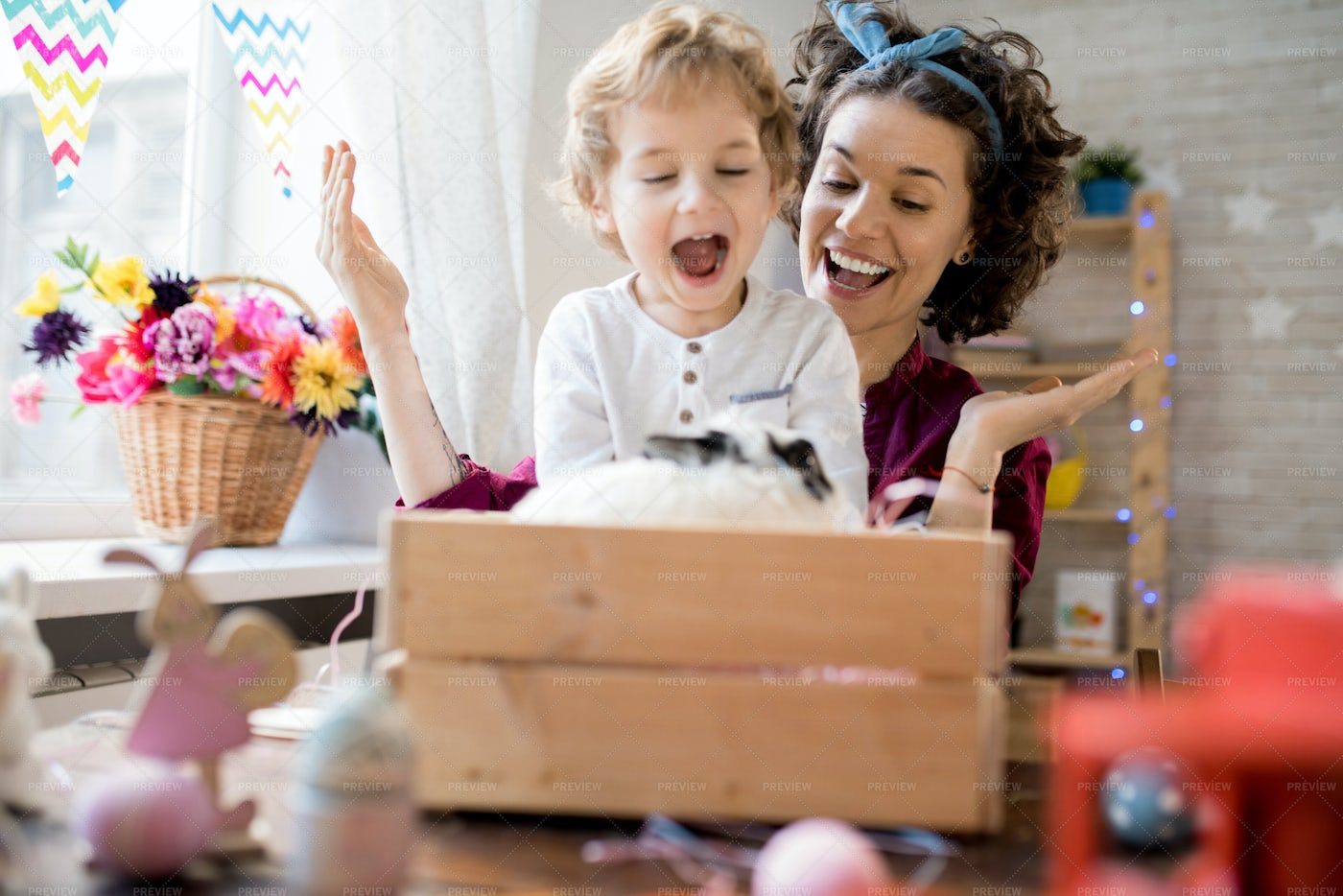 Young Mother Presenting Easter...: Stock Photos