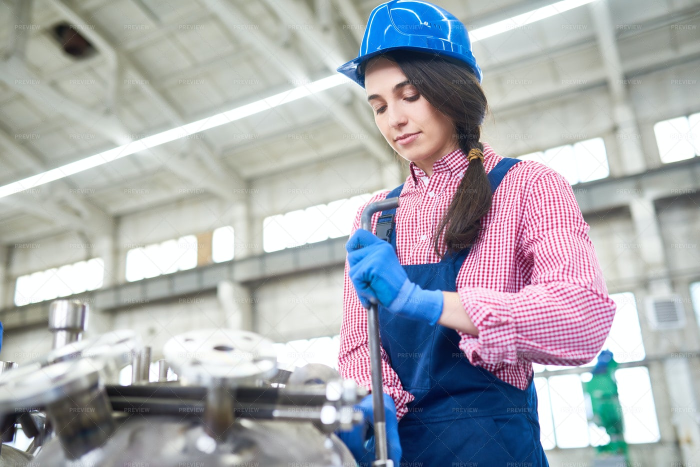 Young Woman Working At Plant: Stock Photos