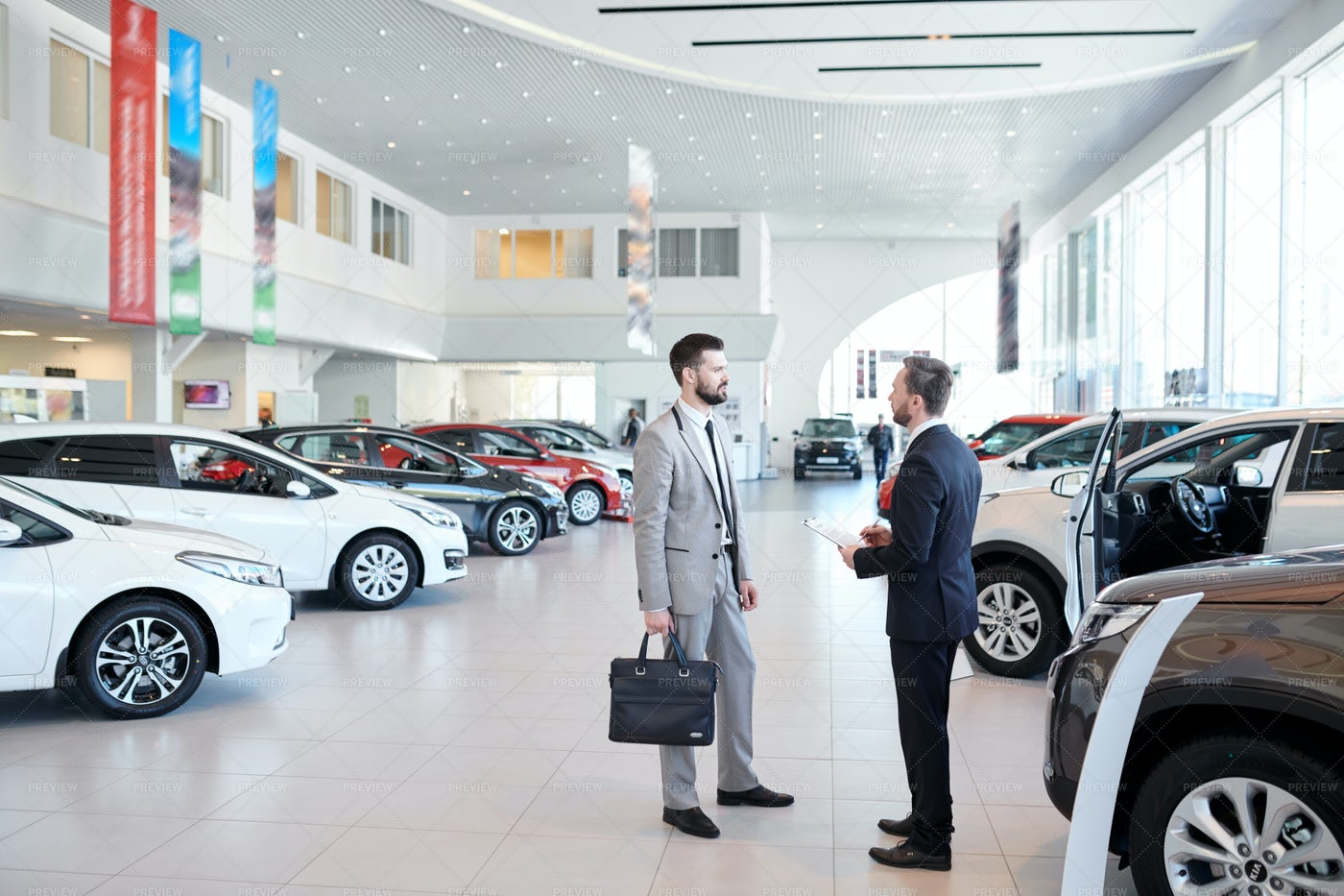 Car Salesman Consulting Client: Stock Photos
