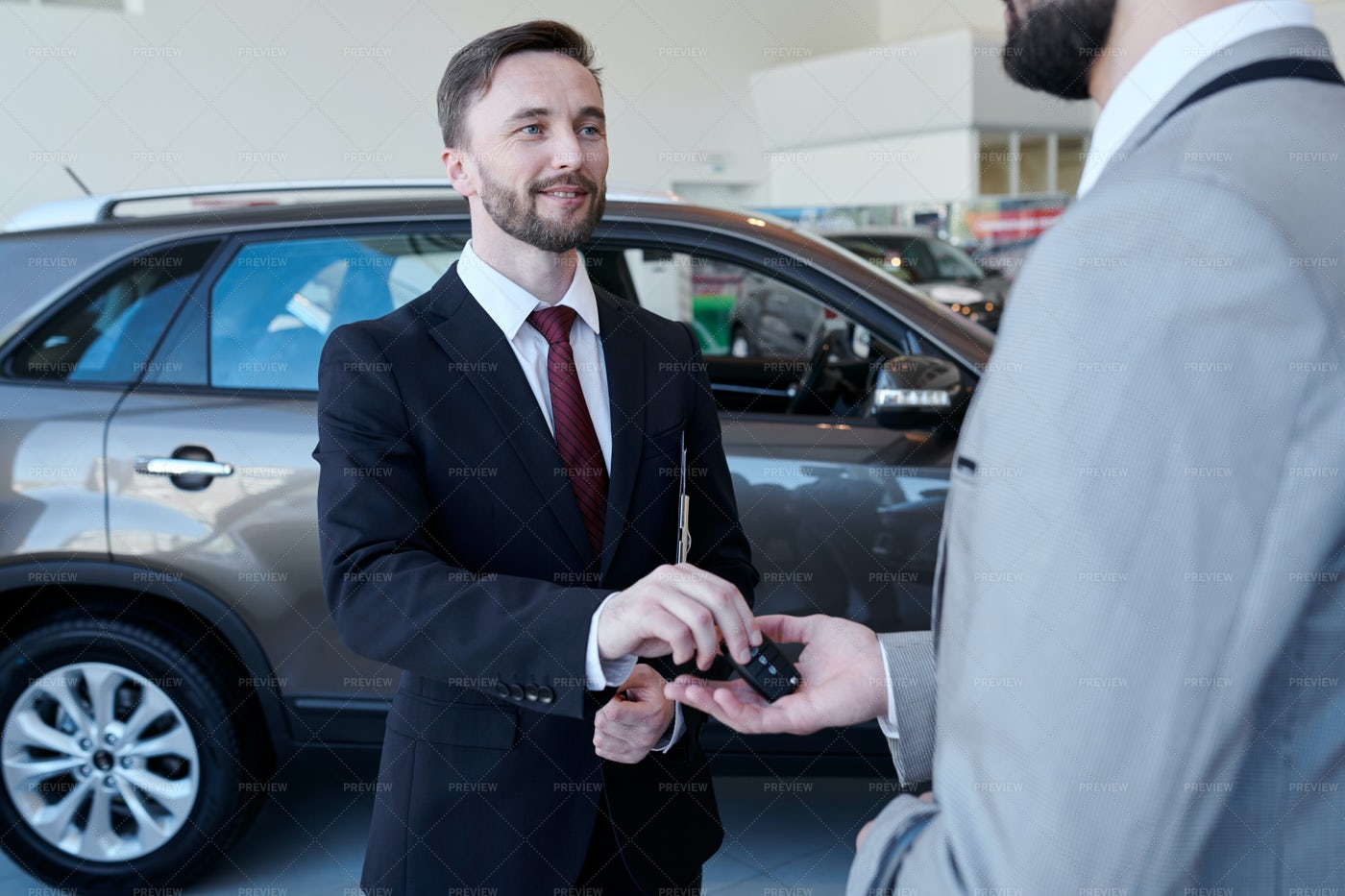 Car Salesman Giving Keys To Client: Stock Photos