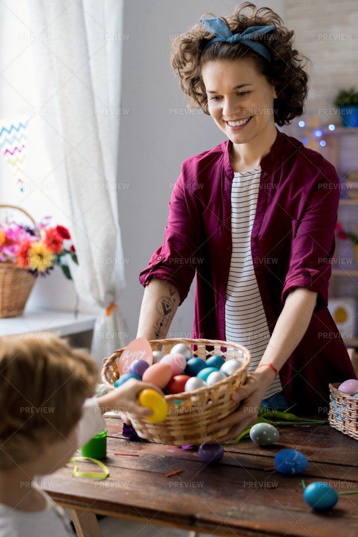 Young Woman Giving Out Easter Eggs: Stock Photos