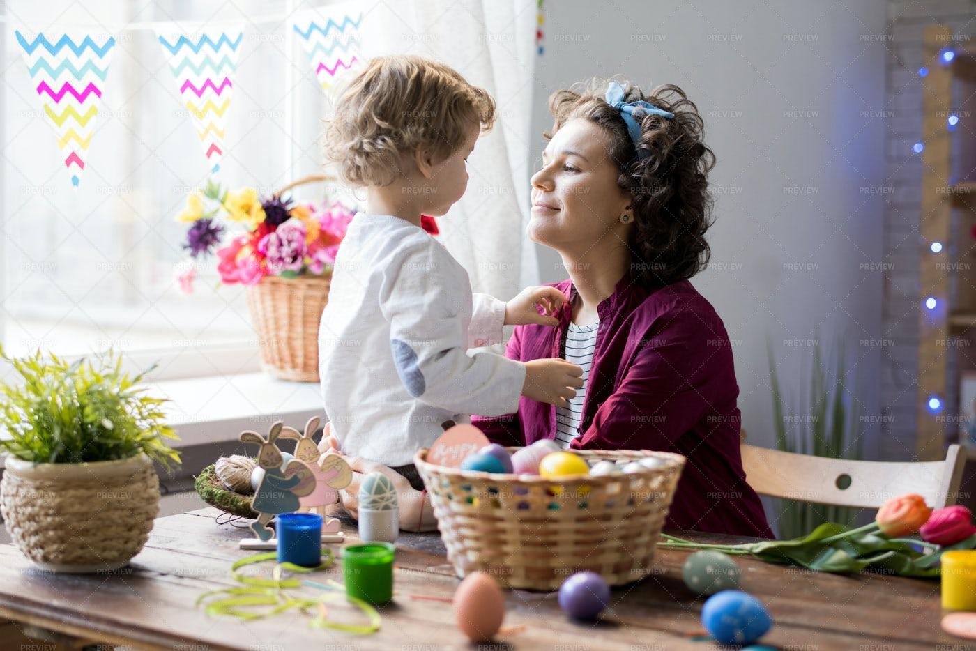 Loving Family Celebrating Easter At...: Stock Photos