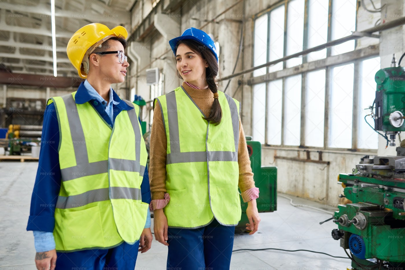 Two Female Workers At Modern Plant: Stock Photos
