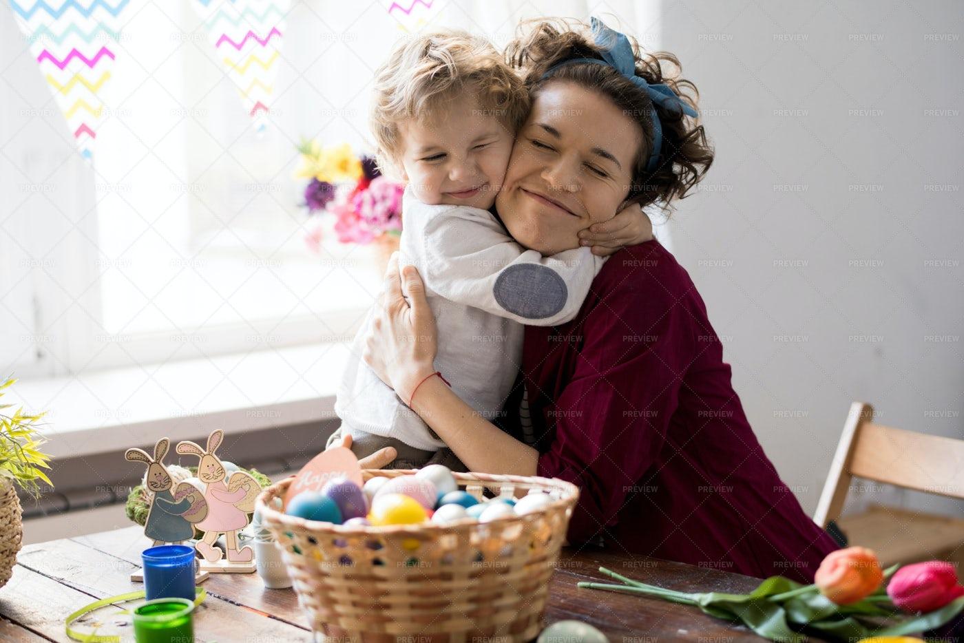 Little Boy Hugging Mom On Easter: Stock Photos