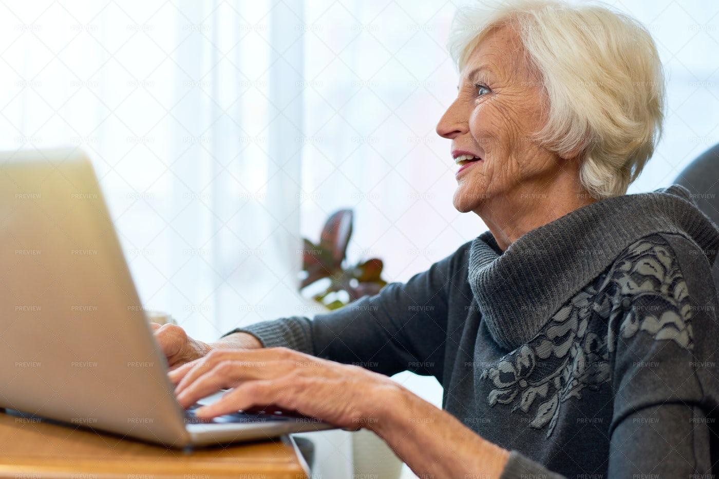 Senior Woman Browsing Internet: Stock Photos