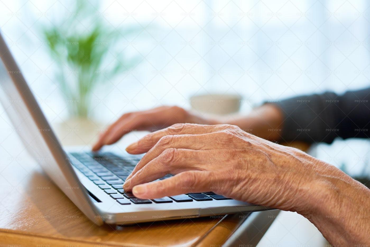 Elderly Woman Using Laptop: Stock Photos