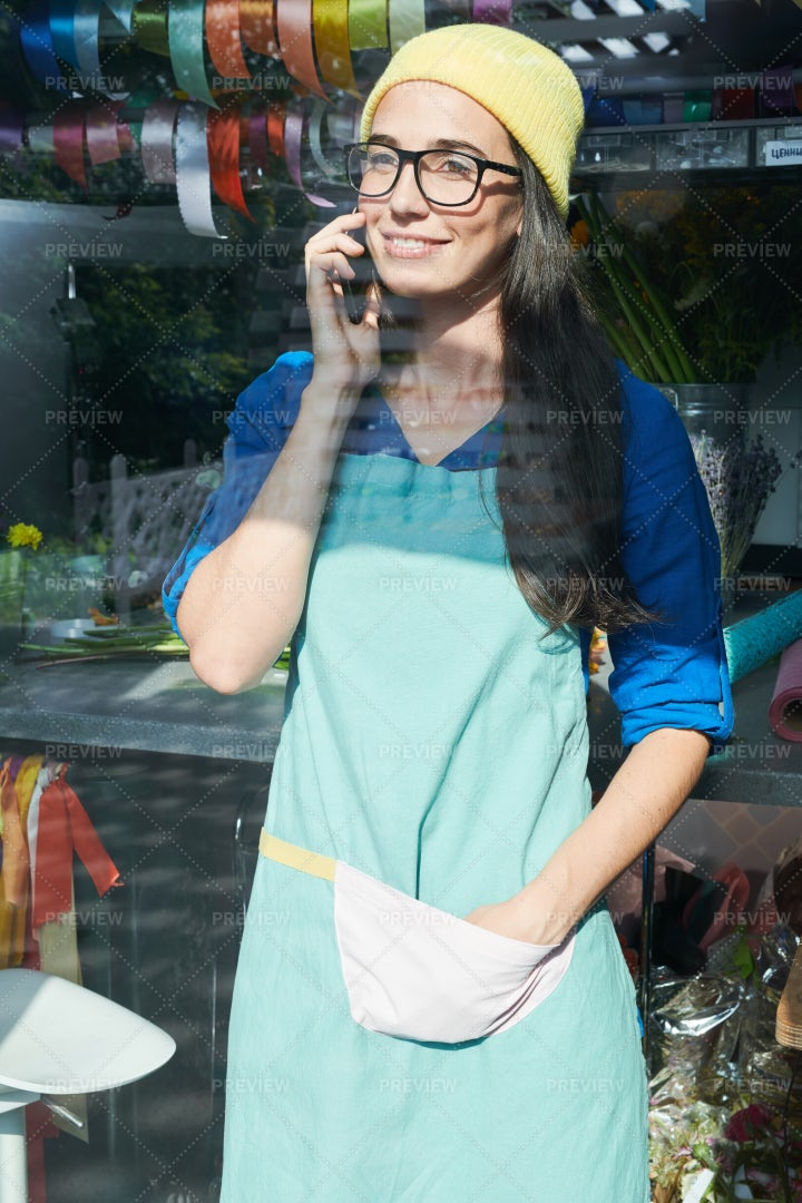 Flower Shop Girl Speaking By Phone: Stock Photos