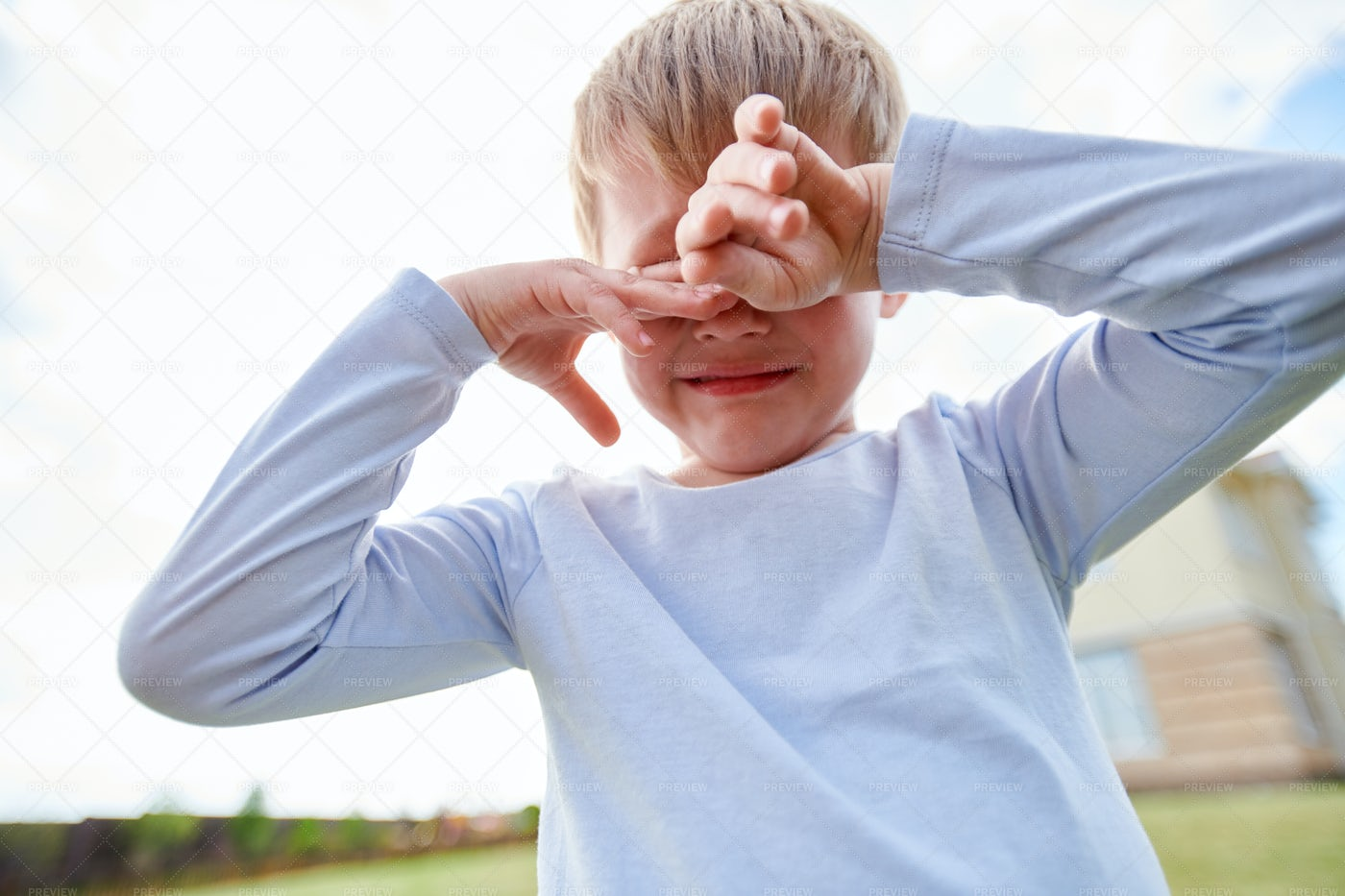 Crying Little Boy On Playground: Stock Photos