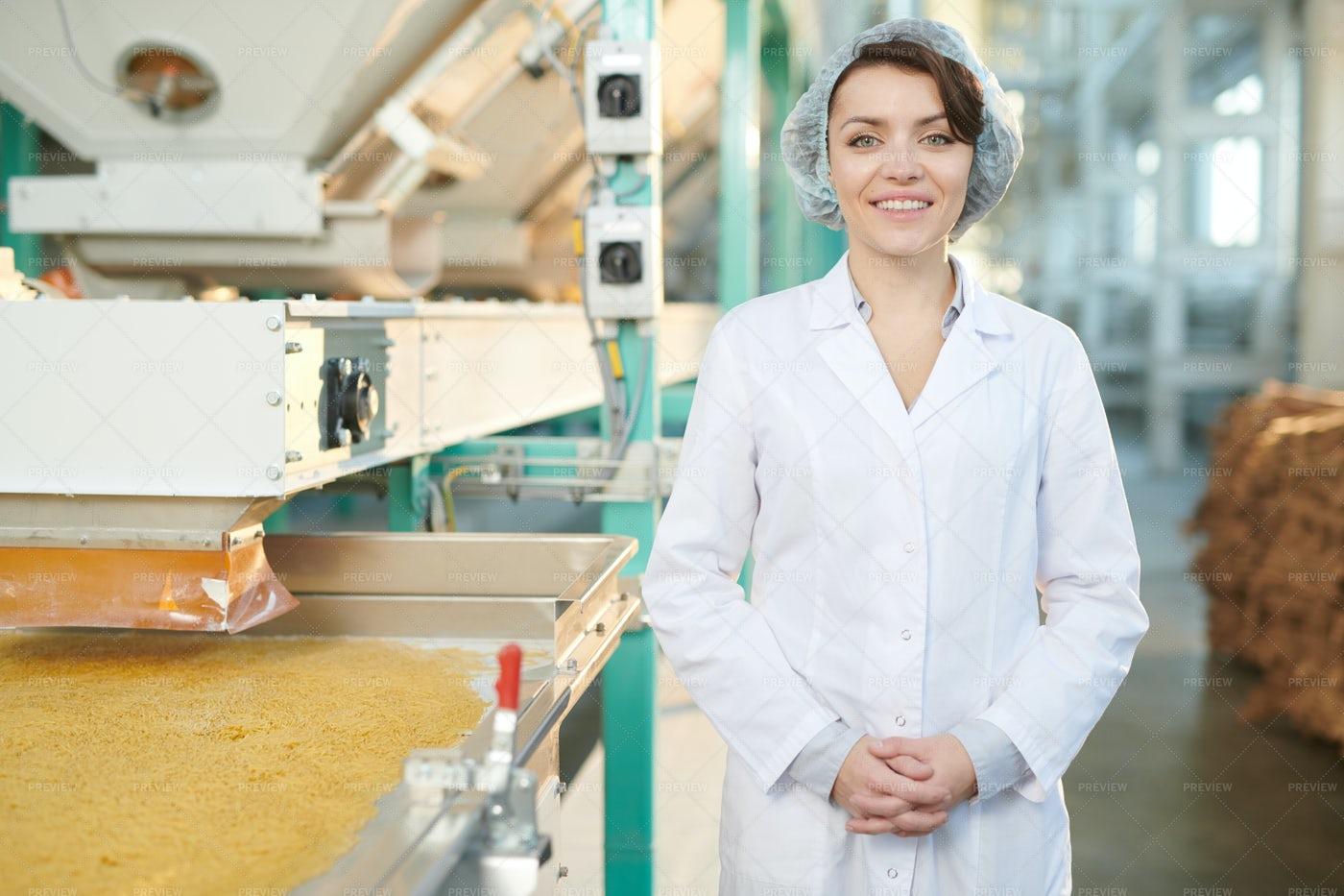 Smiling Woman At Food Factory: Stock Photos