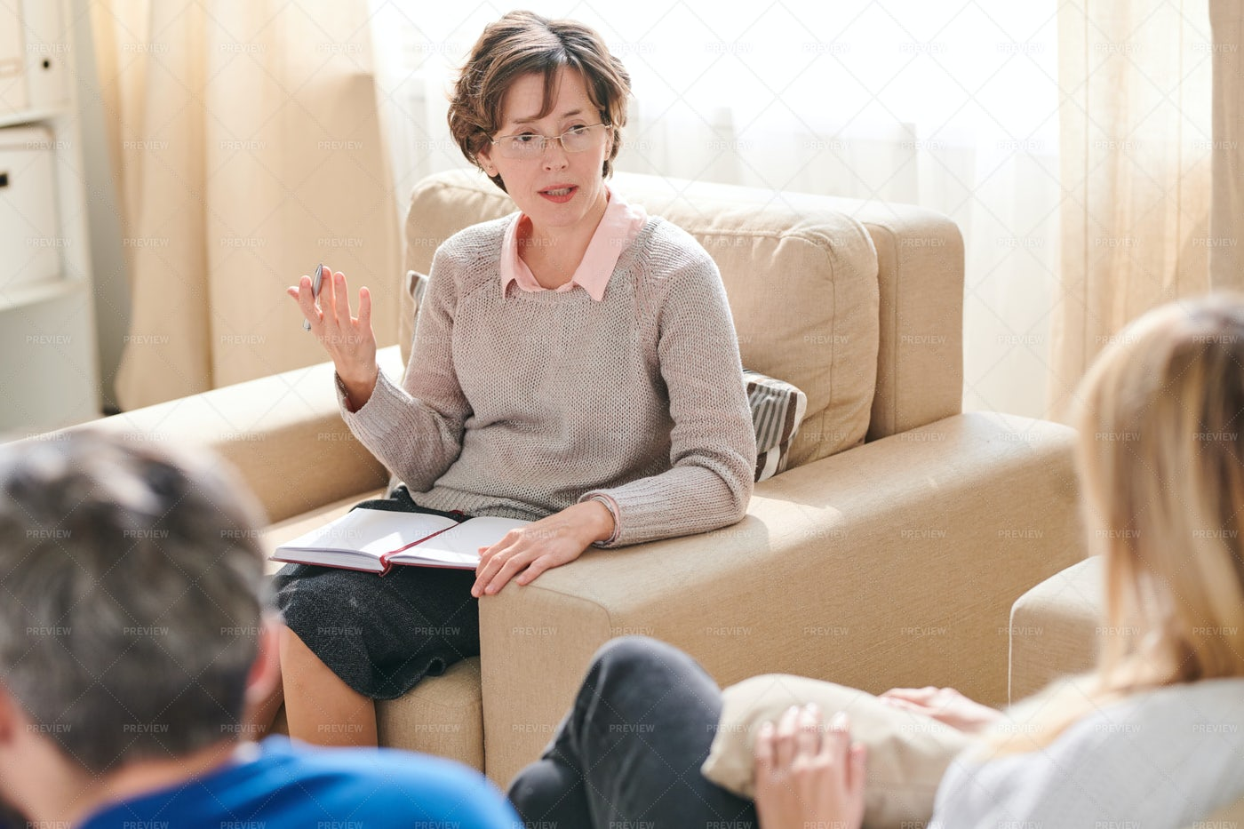 Lady Psychologist Giving Advice To...: Stock Photos