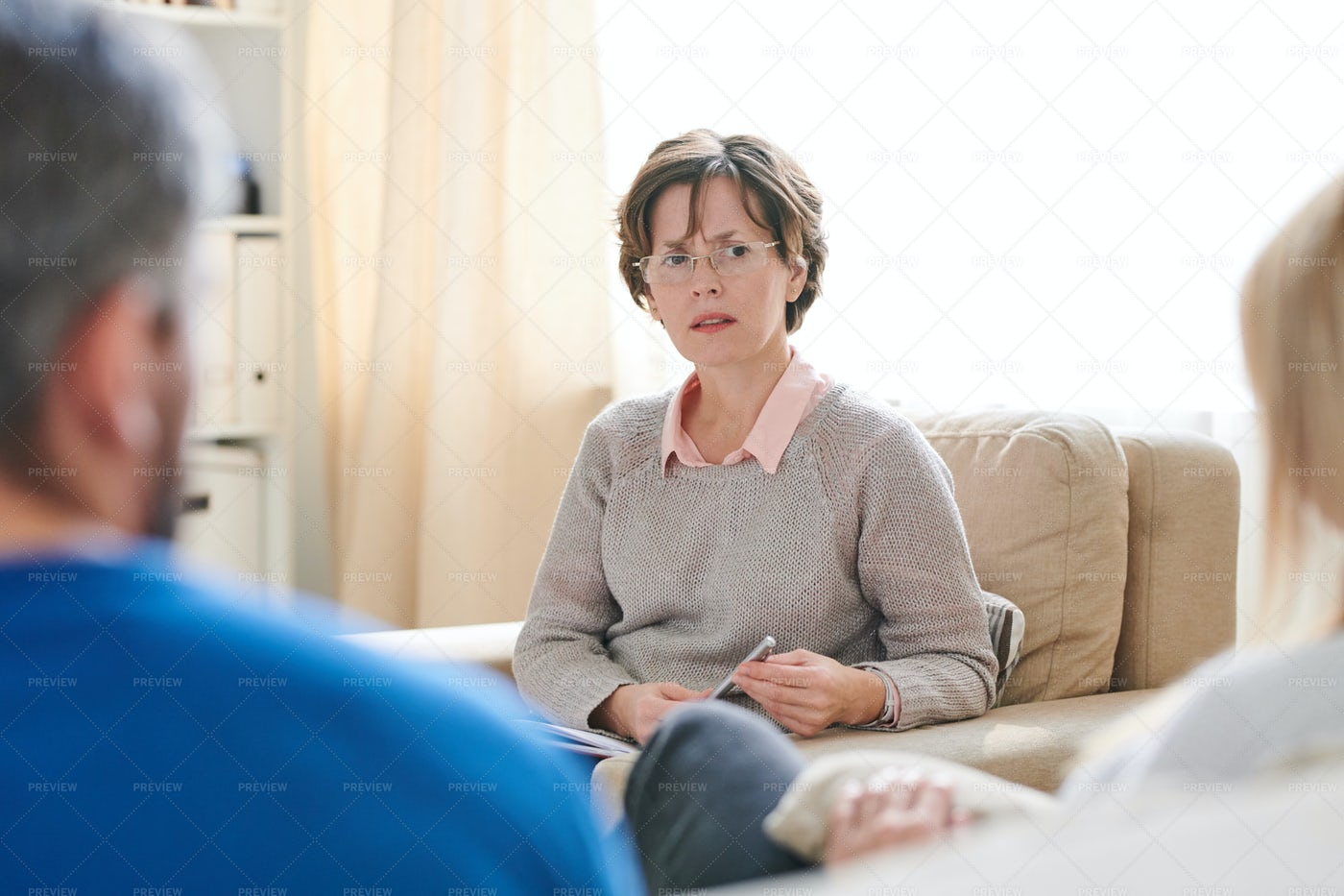 Puzzled Psychologist Listening To...: Stock Photos