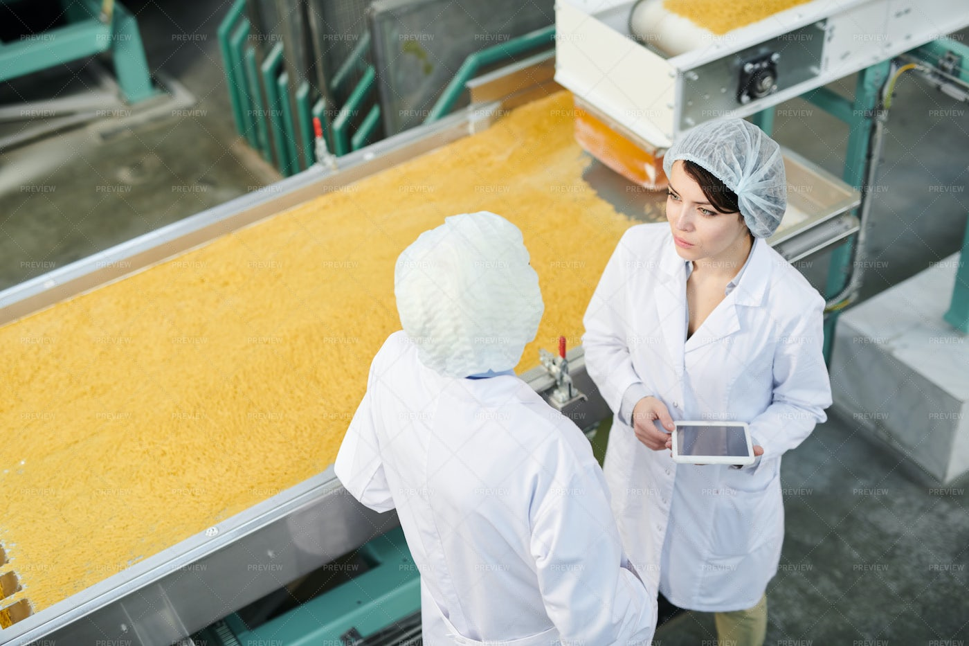 Two Workers At Production Line: Stock Photos
