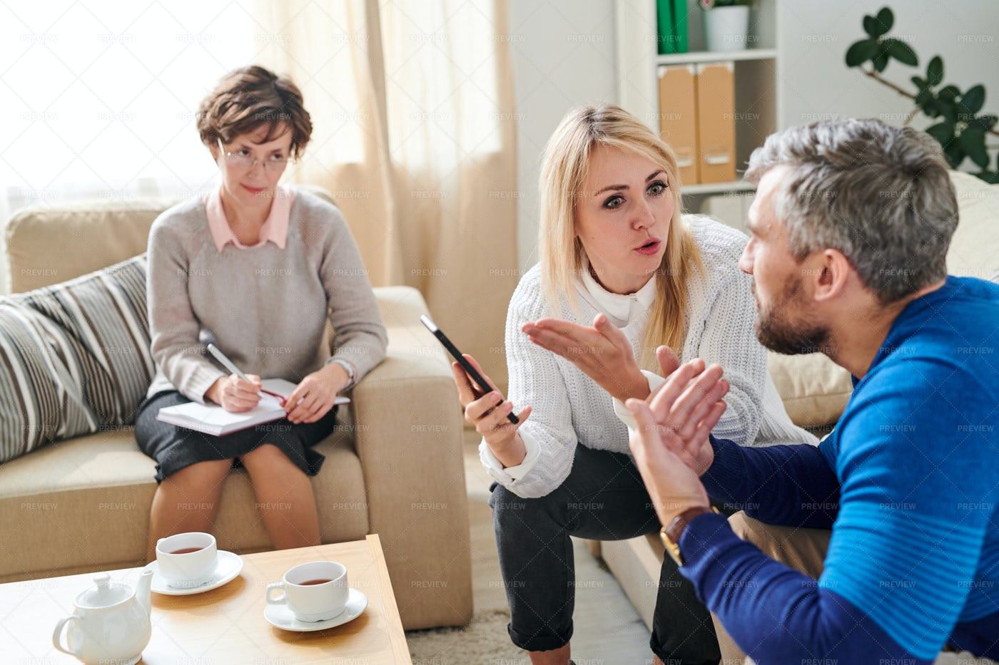 Sad Wife Fighting With Cheating...: Stock Photos