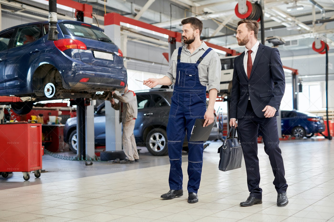 Worker Giving Tour Of Car Factory: Stock Photos