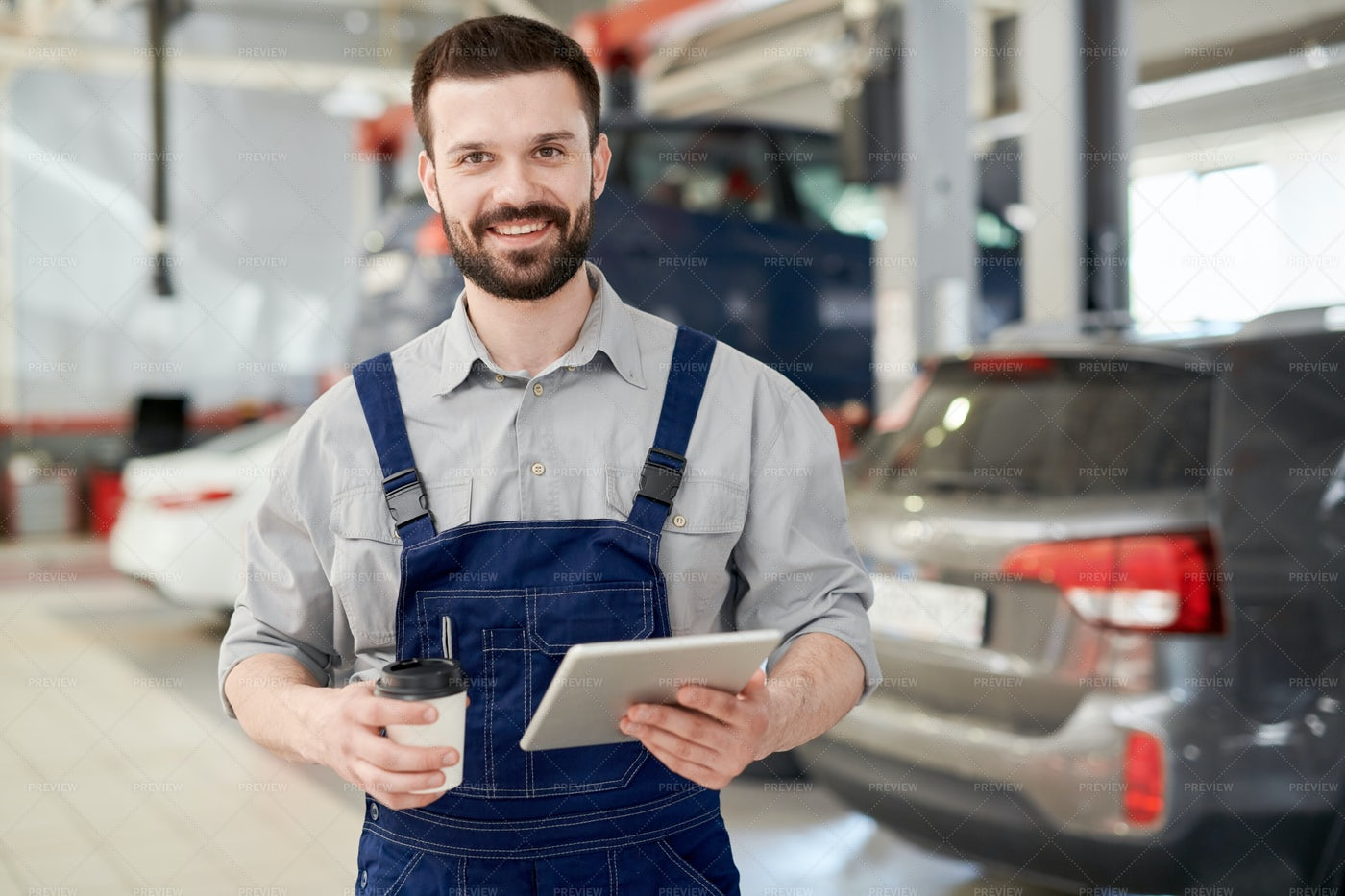 Smiling Worker In Car Service: Stock Photos
