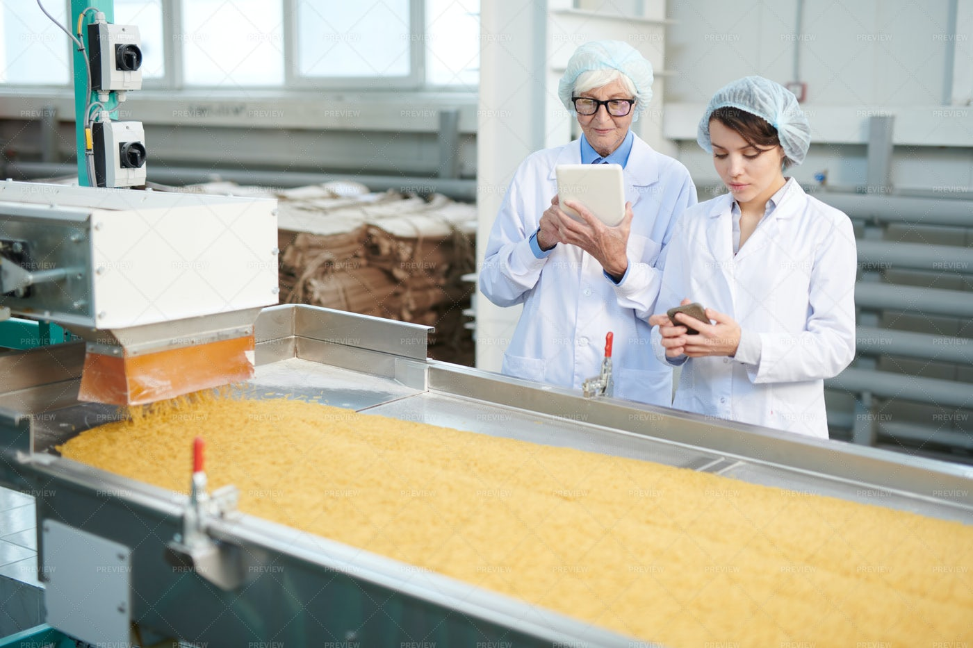 Women Overseeing Production At...: Stock Photos