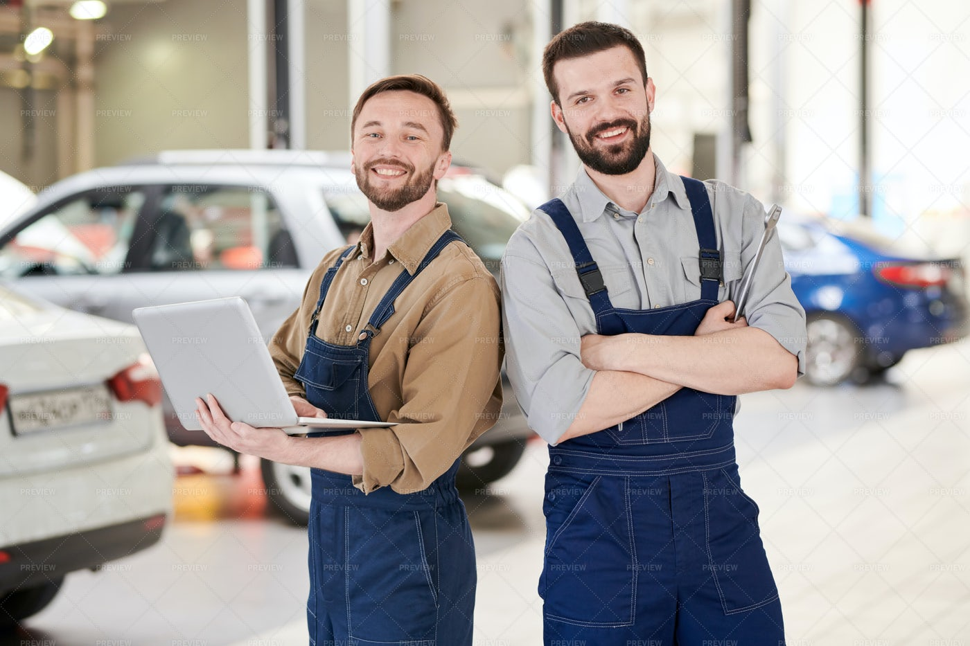 Two Workers In Car Service: Stock Photos