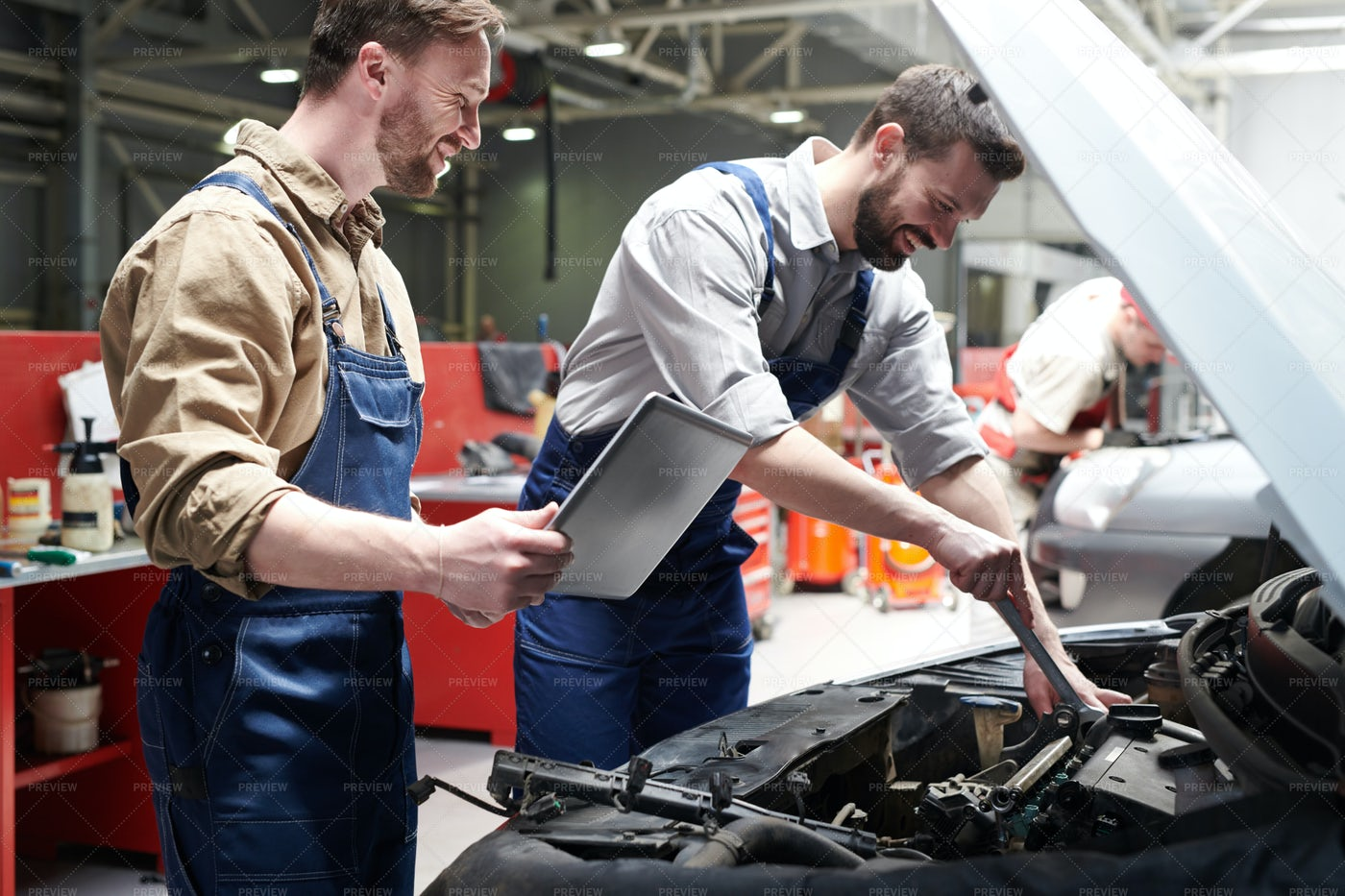 Workers Checking Car In Service: Stock Photos