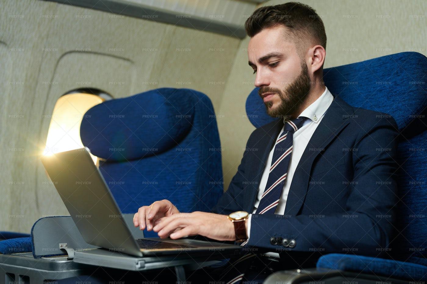 Businessman Working In Plane: Stock Photos