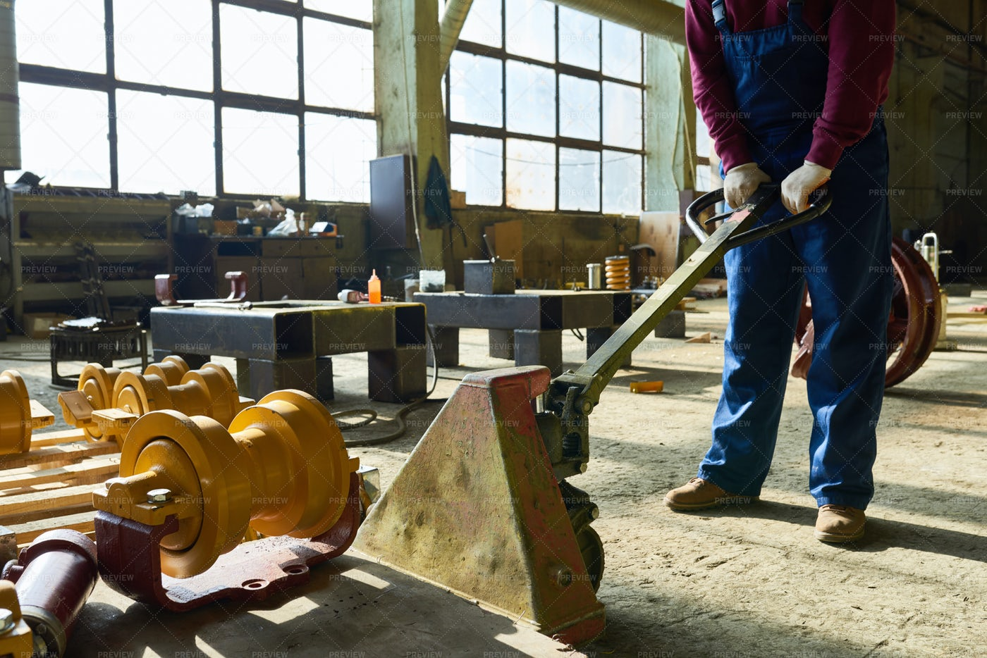 Using Pallet Jack In Warehouse: Stock Photos