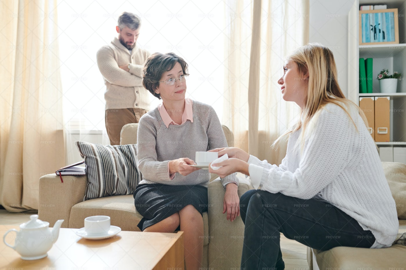 Careful Psychologist Giving Cup Of...: Stock Photos