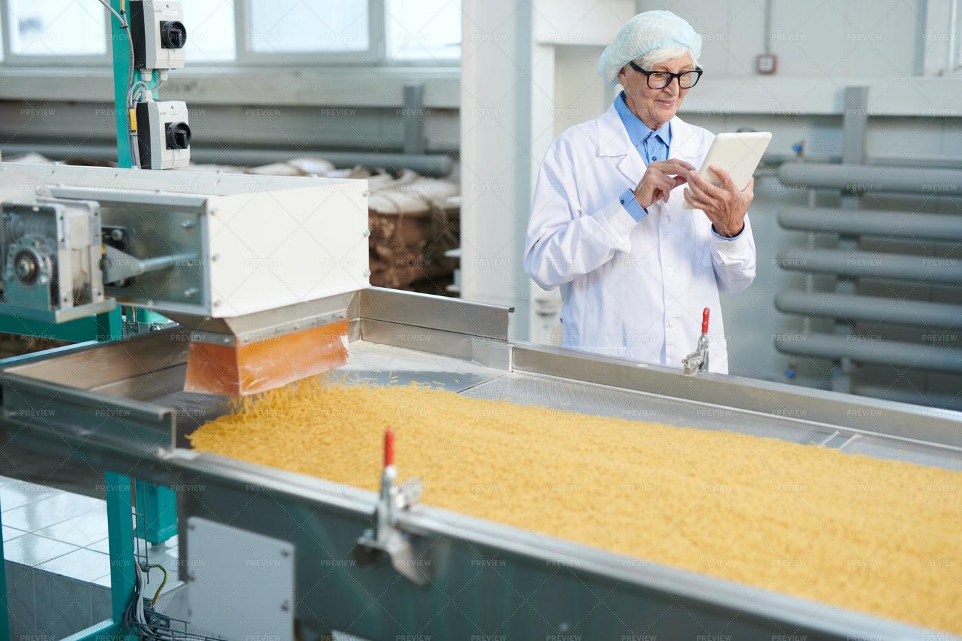 Senior Woman Inspecting Food...: Stock Photos