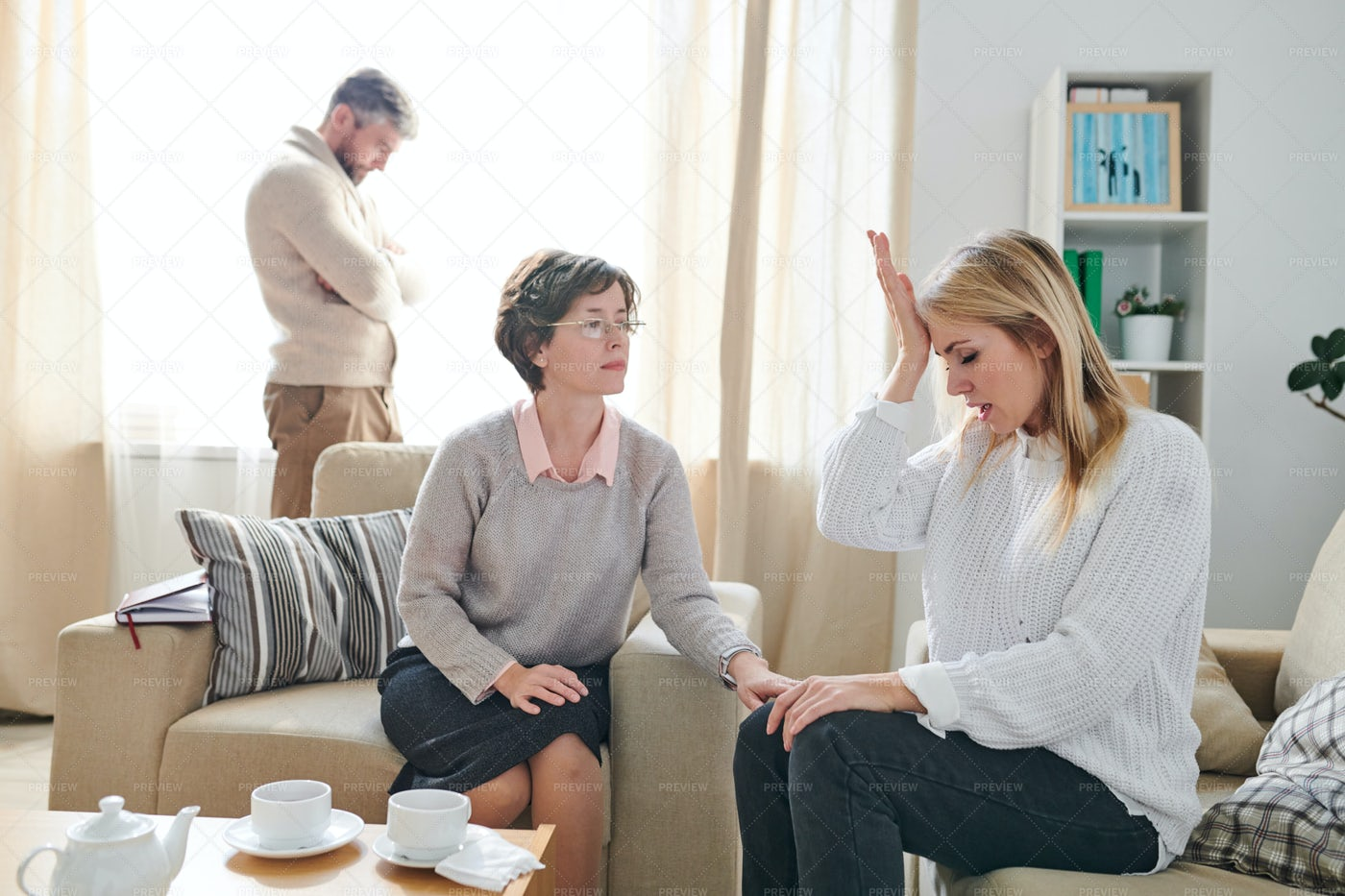 Worried Married Woman Hitting Her...: Stock Photos