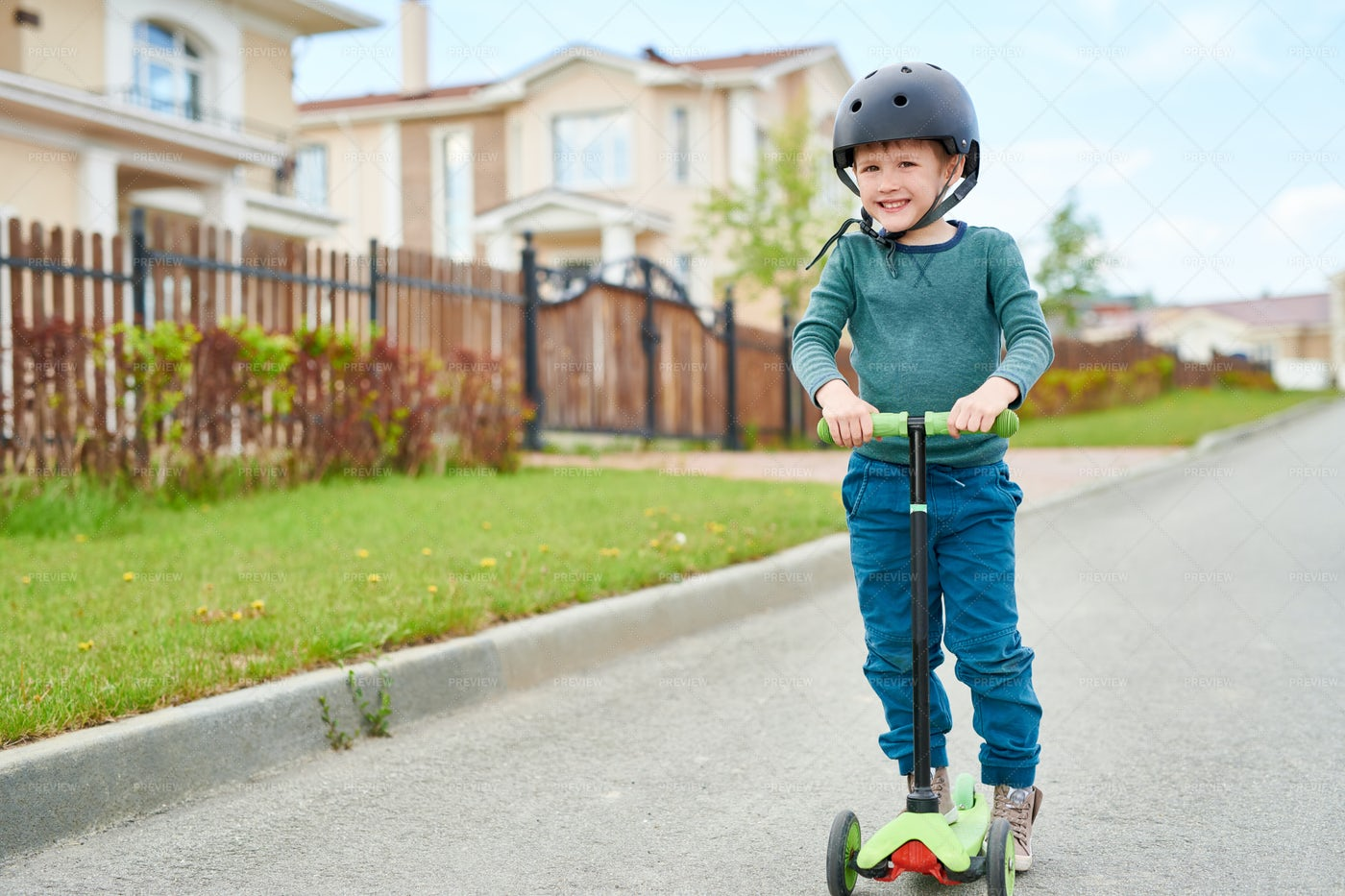 Smiling Boy  Riding Scooter: Stock Photos