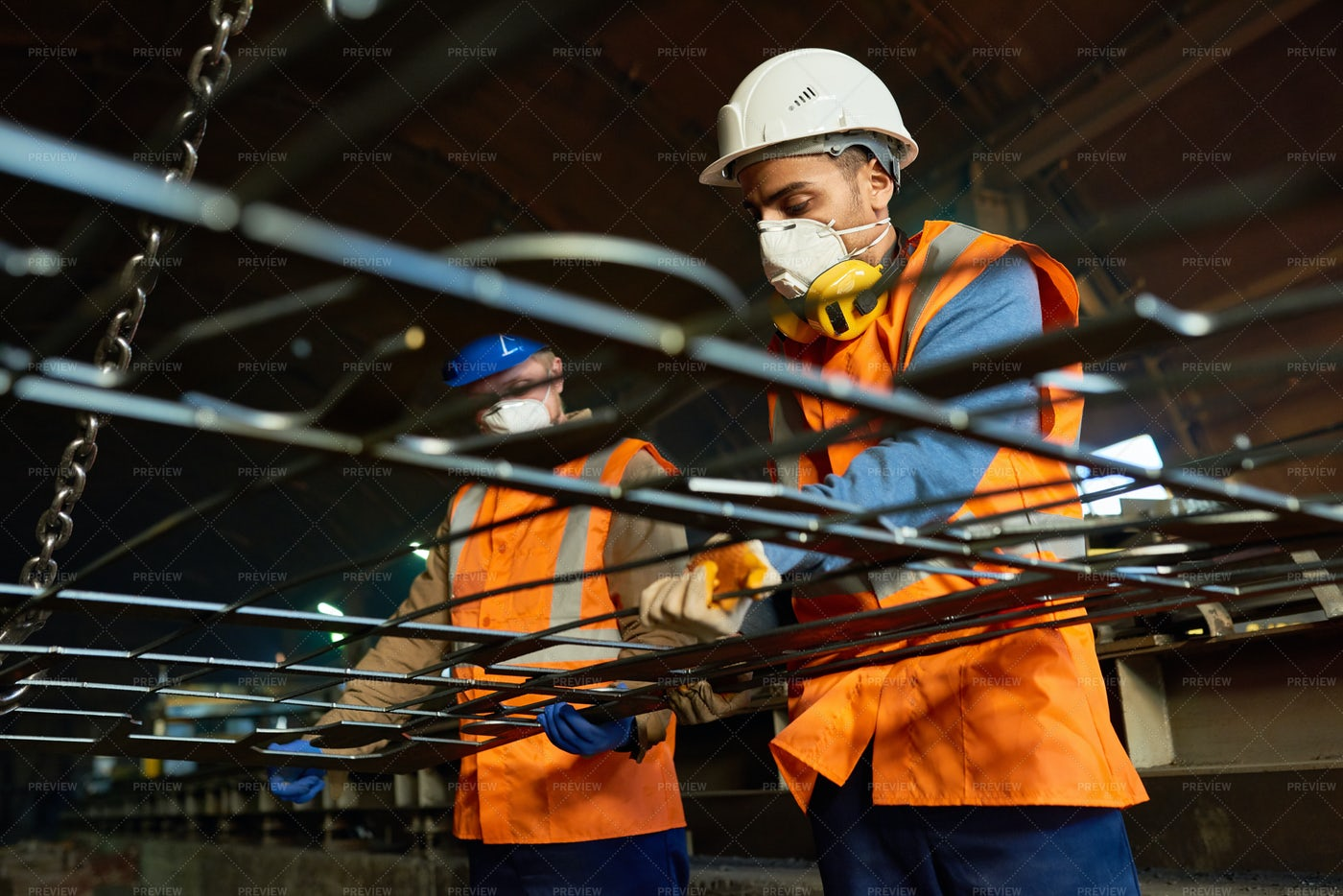 Young Workers Using Lifting Beam: Stock Photos