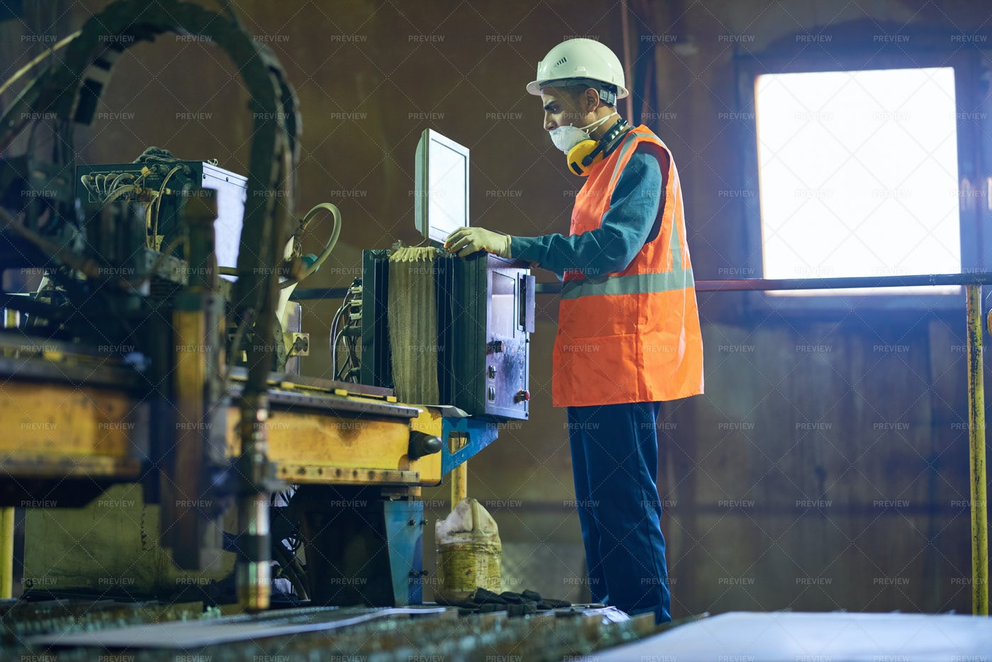 Machine Operator Concentrated On...: Stock Photos