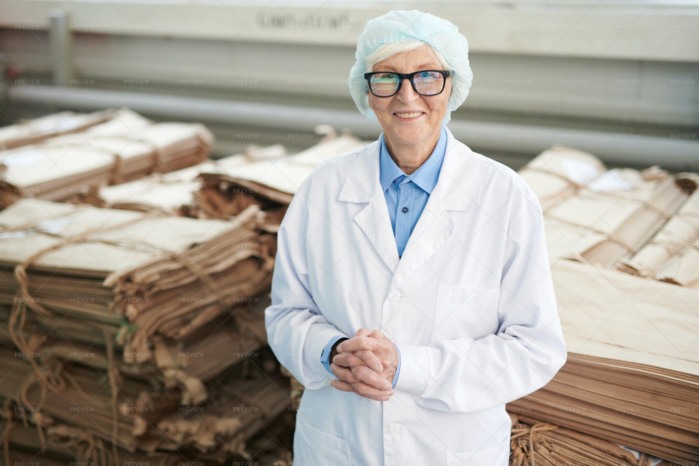 Senior Worker At Recycling Plant: Stock Photos