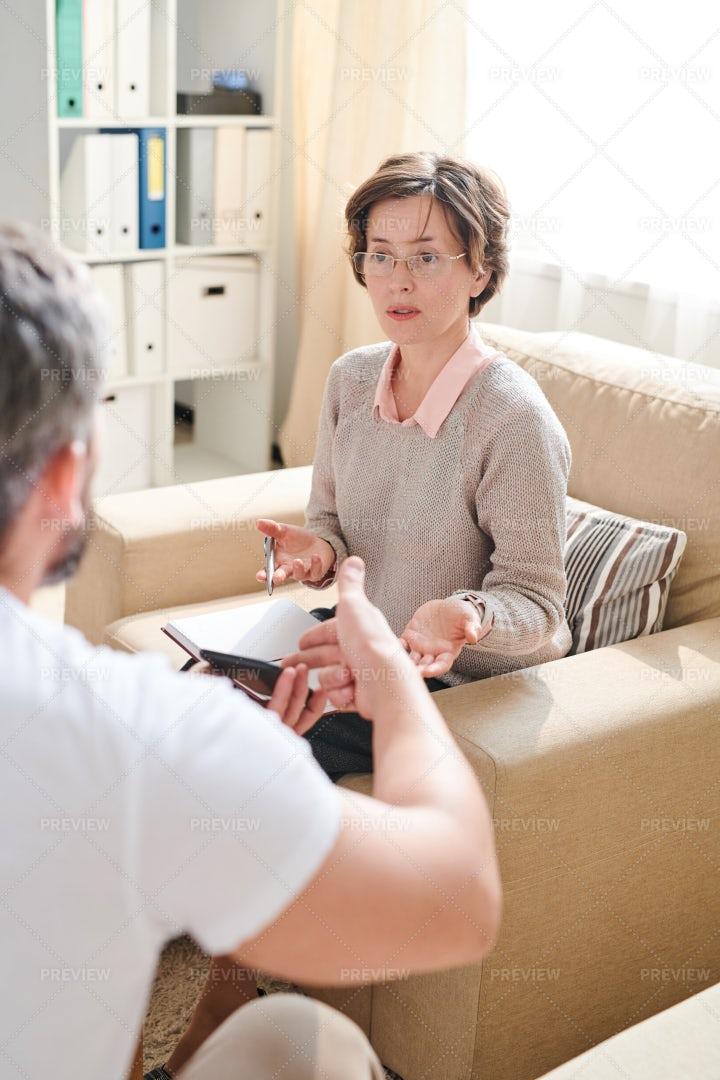 Qualified Psychiatrist Discussing...: Stock Photos