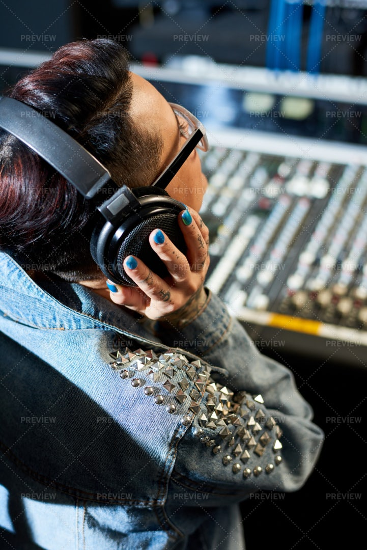 Producer Listening To Audio Track...: Stock Photos