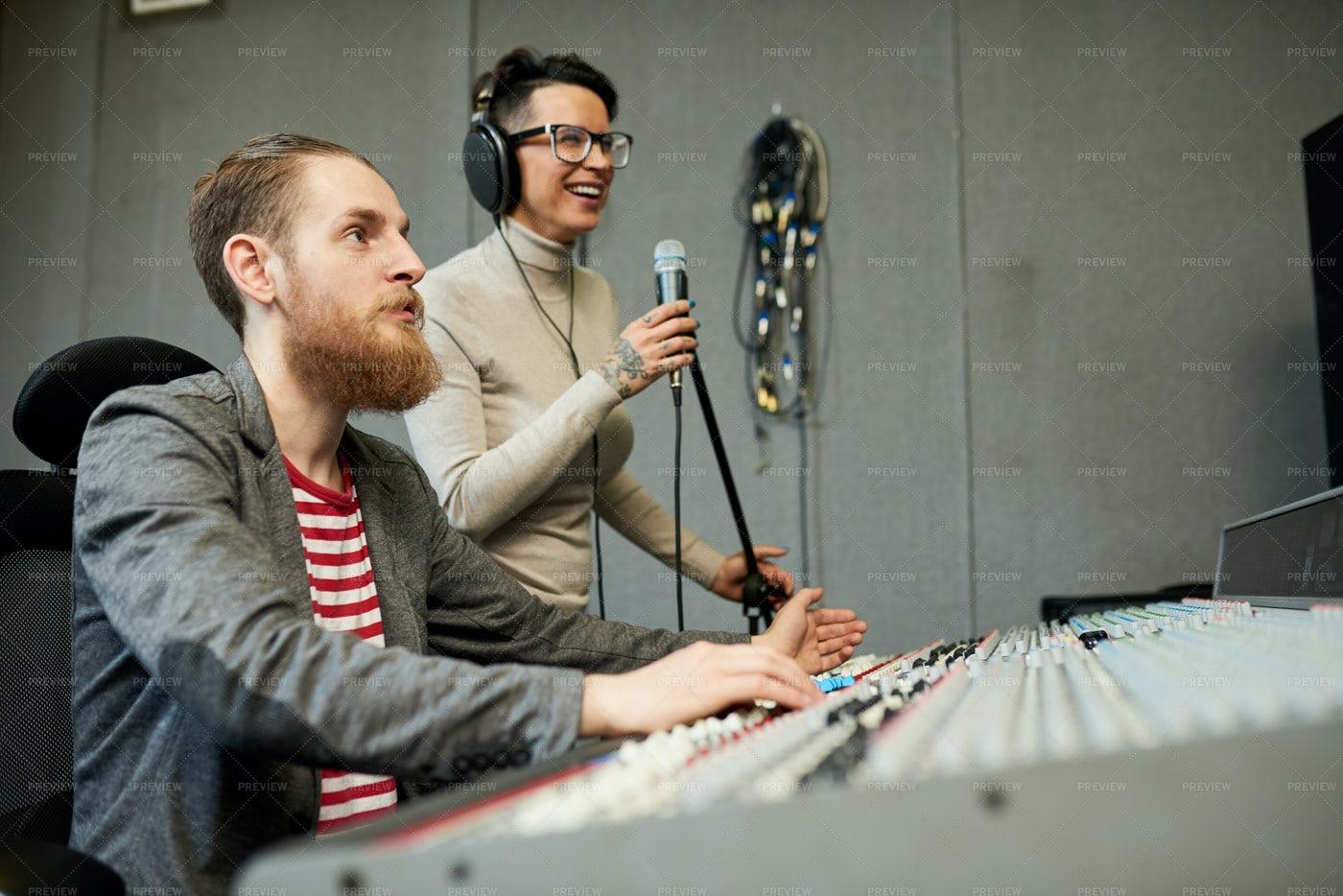 Sound Designer And Singer Recording...: Stock Photos
