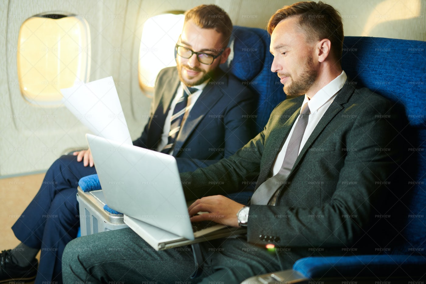 Unrecognizable Businessman In Plane: Stock Photos