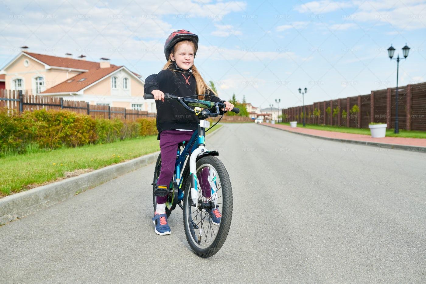 Girl Riding Bike: Stock Photos