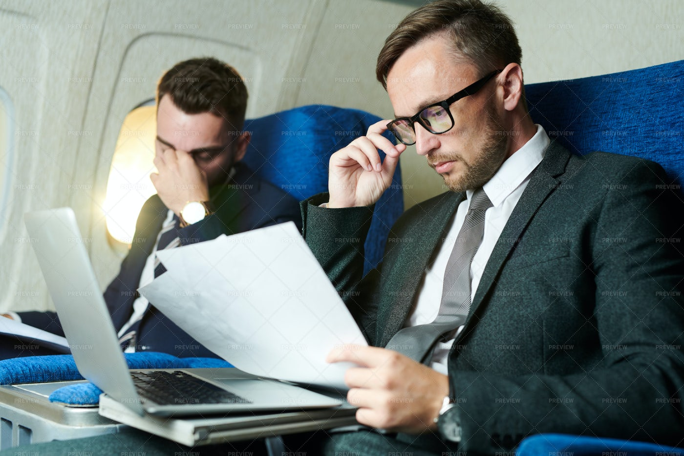 Business People Working In Airplane: Stock Photos