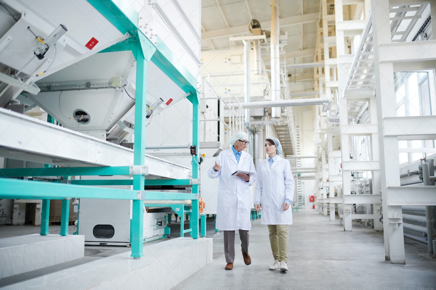 Workers At Clean Factory: Stock Photos