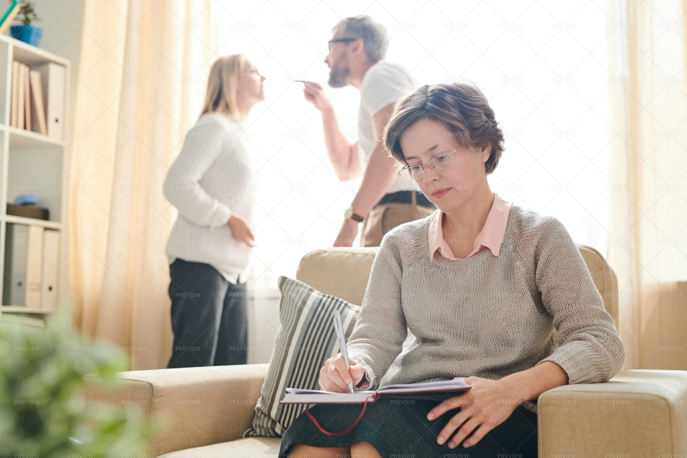 Psychologist Making Notes While...: Stock Photos