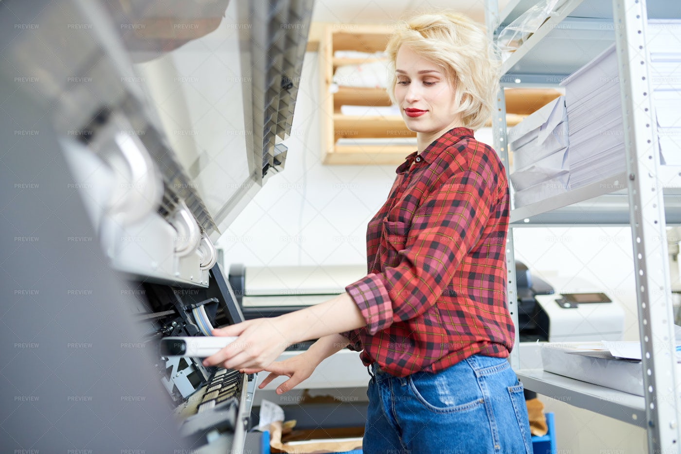 Young Woman Working With Plotter: Stock Photos