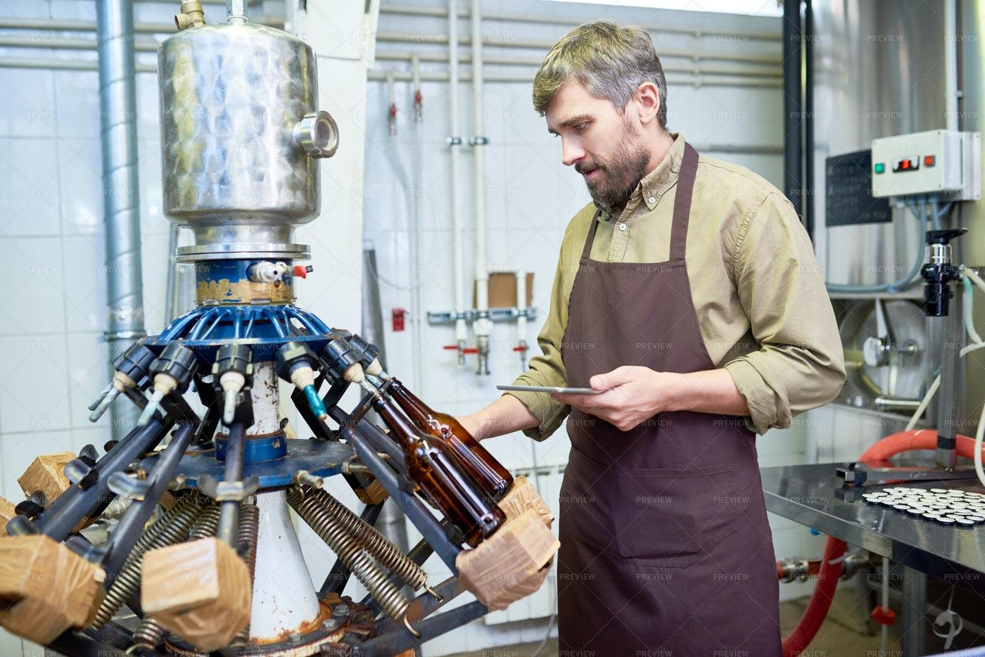 Machine Operator At Modern Brewery: Stock Photos