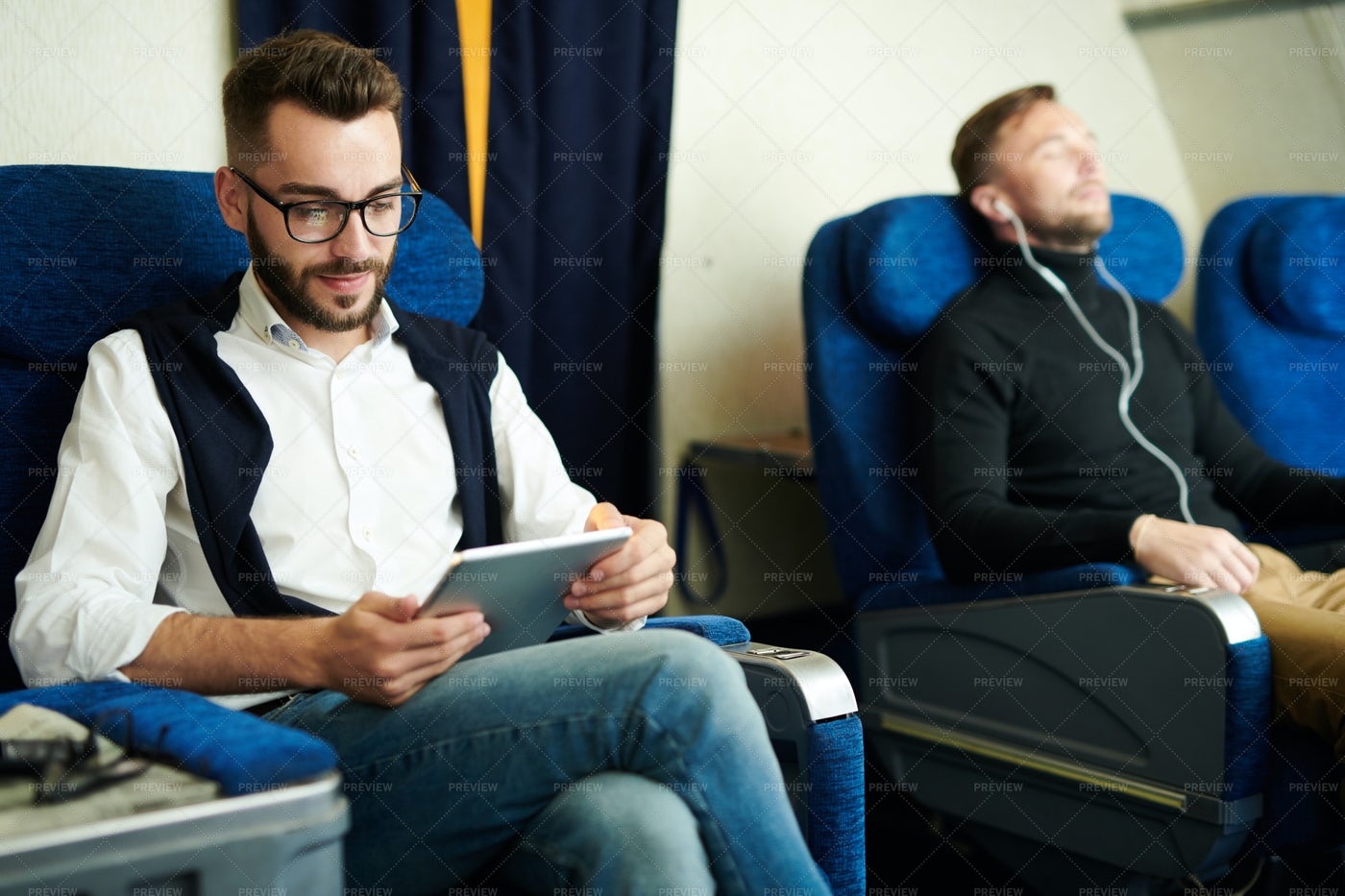 Man Using Tablet In Plane: Stock Photos