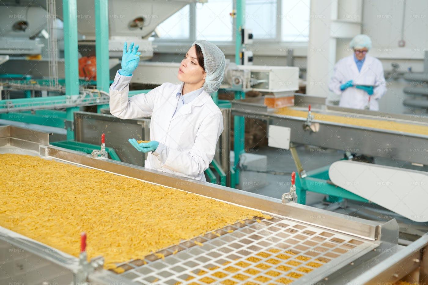 Young Woman At Food Conveyor: Stock Photos